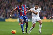 Wilfried Zaha of Crystal Palace and Neil Taylor of Swansea City compete for the ball. Barclays Premier League match, Crystal Palace v Swansea city at Selhurst Park in London on Monday 28th December 2015.<br /> pic by John Patrick Fletcher, Andrew Orchard sports photography.