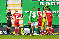 Dylan McGeouch (#15) of Aberdeen FC appeals to referee Willie Collum after a penalty is awarded to Hibs during the SPFL Premiership match between Hibernian and Aberdeen at Easter Road Stadium, Edinburgh, Scotland on 6 February 2021.