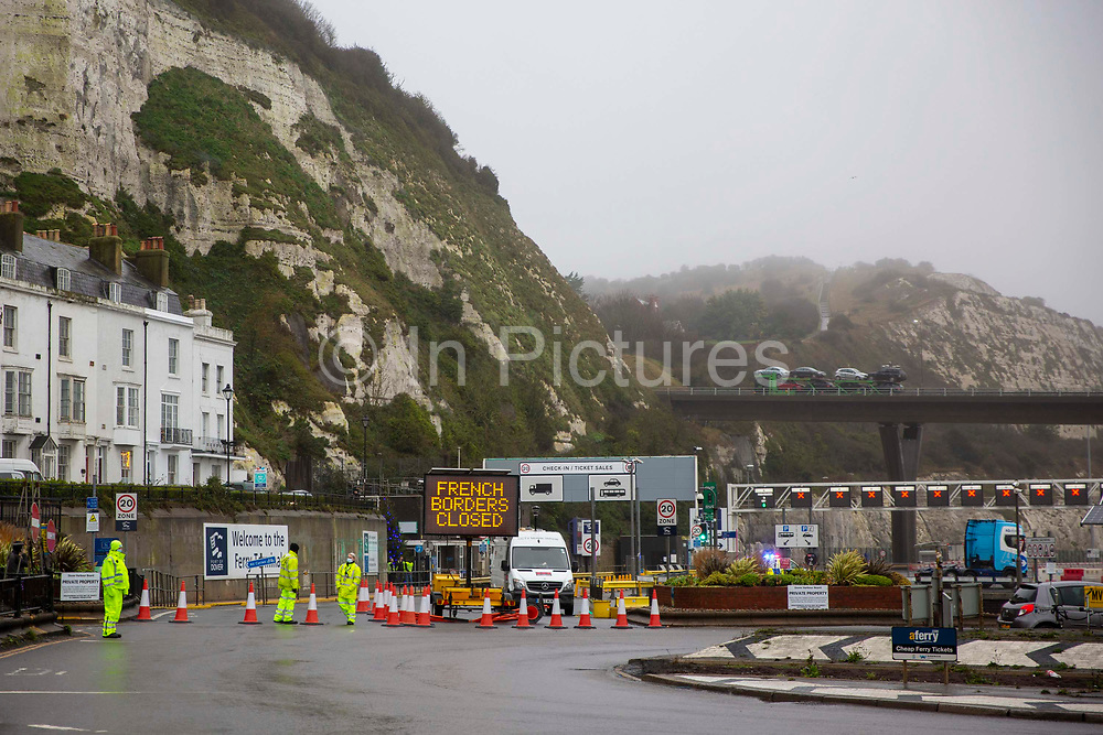 French borders closed sign at the entrance into the port of Dover due to a new strain of COVID-19 in the Eastern Dock where the cross channel port is situated with ferries departing to go to Calais in France on the 21st of December 2020, Dover, Kent, United Kingdom. Dover is the nearest port to France with just 34 kilometres 21 miles between them. It is one of the busiest ports in the world. As well as freight container ships it is also the main port for P&O and DFDS Seaways ferries.