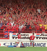 Mark Kinsella (Charlton Athletic) celebrates his goal with the fans. Charlton Athletic v Manchester City 19/8/2000. Credit: Andrew Cowie / Colorsport.