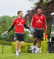 CARDIFF, WALES - Wednesday, June 1, 2016: Wales' Andy King and captain Ashley Williams before a training session at the Vale Resort Hotel ahead of the International Friendly match against Sweden. (Pic by David Rawcliffe/Propaganda)