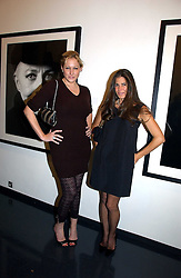 Left to right, AMY SACCO and ELIZABETH SALTZMAN at a private view of an exhibition of portrait photographs by Danish photographer Marc Hom held at the Hamiltons Gallery, 13 Carlos Place, London on 23rd October 2006.<br />