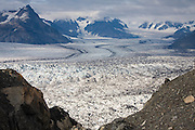 Top view of the surrounding peaks and the moraines, seracs and crevasses on the surface of the Columbia Glacier, near Valdez, Alaska.