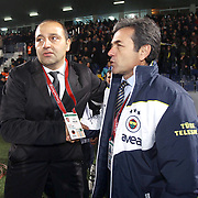 Genclerbirligi's coach Fuat Capa (L) and Fenerbahce's coach Aykut Kocaman (R) during their Turkish Superleague soccer match Genclerbirligi between Fenerbahce at the 19 Mayis stadium in Ankara Turkey on Friday 25 November 2011. Photo by TURKPIX