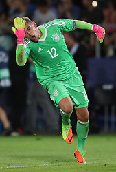 Germany goalkeeper Julian Pollersbeck celebrates his side's first goal of the game