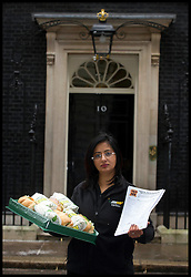 Rachana Pancholi from Derbyshire and Leicestershire joins other Subway Franchisees and  subway owner David Cameron to deliver a petition to Downing Street from Subway, Tuesday January 22, 2013. Photo: Andrew Parsons / i-Images