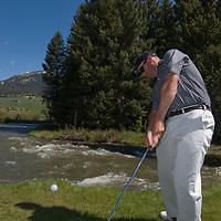Sam Woodger plays beside a stream at Big Sky Golf Course in Big Sky, Montana.