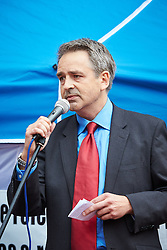 © Licensed to London News Pictures.  20/09/2014. LONDON, UK. Paul Weston, chairman on political party Liberty GB makes a speech during an English Defence League (EDL) rally opposite Downing Street. The group is attempting to highlight it belief that  Muslim sexual grooming gangs are abusing English girls. Earlier this week a home office official warned of the rise of the far right. Photo credit: Cliff Hide/LNP