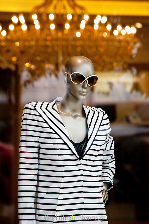 A mannequin dressed in the window of a boutique clothes store on the Corniche of Beirut, Lebanon