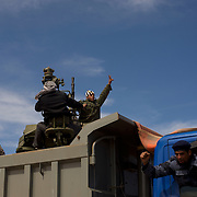 Rebel fighters celebrate the retake of Ajdabiya from the hands of the Libyan army.