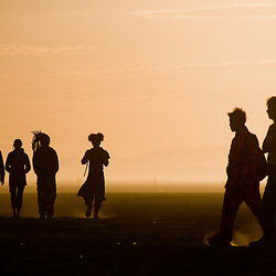 Aug. 30 2008 - Black Rock City, Nevada, USA - Festival goers walk on the playa Saturday morning, Aug. 30, 2008, during the Burning Man arts and culture festival in Black Rock City in the Black Rock Desert near Gerlach, Nev. (Credit Image: © David Calvert/ZUMA Press)