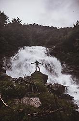 THEMENBILD - ein Mann steht auf einem Felsen bei einem Waserfall waehrend einer Wanderung entlang des Wasserfallweges, aufgenommen am 28. Juli 2019 in Fusch a. d. Grossglocknerstrasse, Oesterreich // a man standing on a rock infront of an waterfall during a hike along the waterfall trail in Fusch a. d. Grossglocknerstrasse, Austria on 2019/07/28. EXPA Pictures © 2019, PhotoCredit: EXPA/ Stefanie Oberhauser