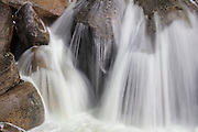 Cascade Creek forms a small waterfall as it flows over rocks near an area known as The Cascades in Yosemite National Park, California.