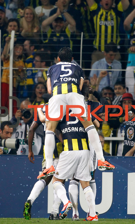 Fenerbahce's celebrate his goal during their Turkish superleague soccer derby match Fenerbahce between Galatasaray at the Sukru Saracaoglu stadium in Istanbul Turkey on Sunday 12 May 2013. Photo by Aykut AKICI/TURKPIX
