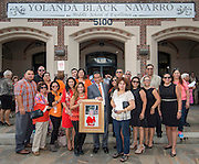 Navarro family members pose for a photograph following a ceremony to rename Jackson Middle School to Navarro Middle School in honor of Yolanda Black Navarro, October 5, 2016.
