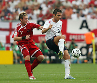 Photo: Chris Ratcliffe.<br /> England v Trinidad & Tobago. Group B, FIFA World Cup 2006. 15/06/2006.<br /> Frank Lampard from England clashes with Chris Birchall from T&T.