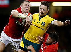 Bernard Foley of Australia under pressure from Hadleigh Parkes of Wales<br /> <br /> Photographer Simon King/Replay Images<br /> <br /> Under Armour Series - Wales v Australia - Saturday 10th November 2018 - Principality Stadium - Cardiff<br /> <br /> World Copyright © Replay Images . All rights reserved. info@replayimages.co.uk - http://replayimages.co.uk
