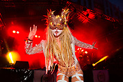Glastonbury Festival, 2015. Shangri La is a festival of contemporary performing arts held each year within Glastonbury Festival. The theme for the 2015 Shangri La was Protest. <br /> Girl in costume and mask dancing on the Hell stage on the last night