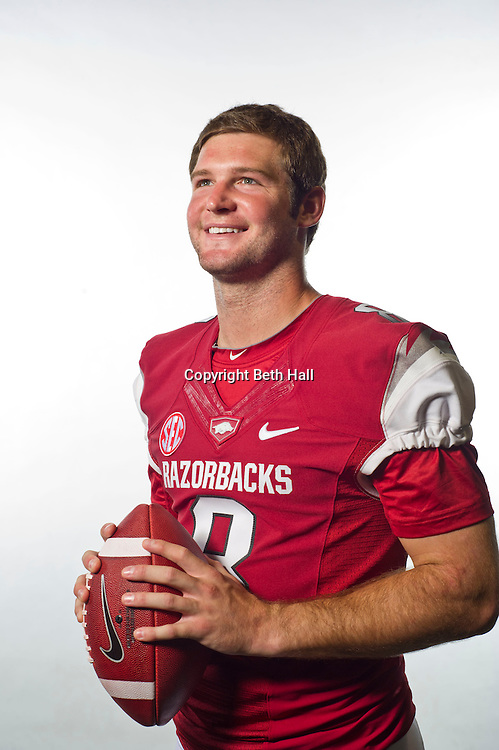 Aug 4, 2012; Fayetteville, AR, USA;  Arkansas Razorback quarterback Tyler Wilson (8) poses for a photo during media day at the Broyles Athletic Center.  Mandatory Credit: Beth Hall-US PRESSWIRE