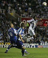 Photo: Lee Earle.<br /> Reading v Newcastle United. The Barclays Premiership. 30/04/2007.Newcastle's Obafemi Martins (R) tries a headed attempt on goal.