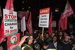 London, UK. 21st January, 2019. James Farrar, Chair of the Independent Workers of Great Britain United Private Hire Drivers branch, addresses hundreds of Uber minicab drivers taking part in a protest outside the offices of Transport for London following the introduction last month of congestion charges for minicabs.