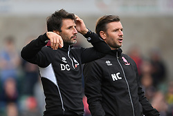 """Lincoln City manager Danny Cowley (left) and his assistant Nicky Cowley during the Skybet League Two match at Sincil Bank Stadium, Lincoln. PRESS ASSOCIATION Photo. Picture date: Saturday September 8, 2018. See PA story SOCCER Lincoln. Photo credit should read: Joe Giddens/PA Wire. RESTRICTIONS: EDITORIAL USE ONLY No use with unauthorised audio, video, data, fixture lists, club/league logos or """"live"""" services. Online in-match use limited to 75 images, no video emulation. No use in betting, games or single club/league/player publications."""