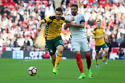 Fedor Cernych of Lithuania battles for possession with Kyle Walker of England during the FIFA World Cup Qualifier group stage match between England and Lithuania at Wembley Stadium, London, England on 26 March 2017. Photo by Matthew Redman.