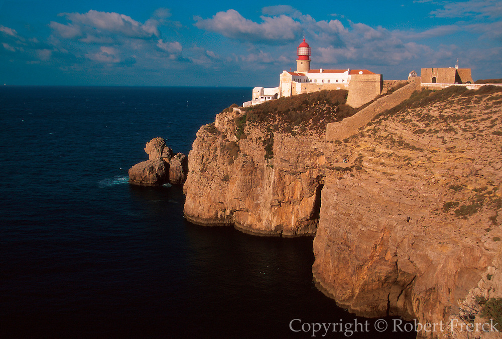 PORTUGAL, ALGARVE, SOUTH COAST Cabo de Sao Vicente, windswept peninsula with lighthouse, marks the point furthest southwest in Europe