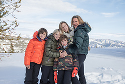 mom with her four children in Winter