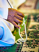 14 JUNE 2017 - BANGKOK, THAILAND: A man and his prayer beads before Iftar at Masjid Hidayatun Islam. Iftar is the evening meal when Muslims end their daily Ramadan fast at sunset. Iftar is a communal event at Masjid Hidayatun Islam and more than a hundred people usually attend the meal.      PHOTO BY JACK KURTZ
