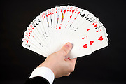 hands with fanned stack of cards double stacked