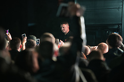 """© Licensed to London News Pictures . 03/11/2017 . Manchester , UK . TOMMY ROBINSON (real name Stephen Yaxley-Lennon ) speaks to supporters at the launch of the former EDL leader's book """" Mohammed's Koran """" at Castlefield Bowl . Originally planned as a ticket-only event at Bowlers Exhibition Centre , the launch was moved at short notice to a public location in the city . Photo credit : Joel Goodman/LNP"""