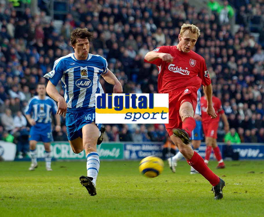 Photo: Jed Wee.<br />Wigan Athletic v Liverpool. The Barclays Premiership. 11/02/2006.<br />Liverpool seem to find the solution to their misfiring strikers, as centre back Sami Hyypia (R) strides through the Wigan defence to score the opening goal.