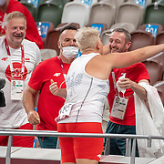 TOKYO, JAPAN August 3:    Gold medal winner Anita Wlodarczyk of Poland is congratulated by Robert Smigielski after the Women's Hammer Throw Final at the Olympic Stadium during the Tokyo 2020 Summer Olympic Games on August 3rd, 2021 in Tokyo, Japan. (Photo by Tim Clayton/Corbis via Getty Images)