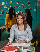 Nataly Degollado poses for a photograph in the college success center at Austin High School, January 23, 2017.