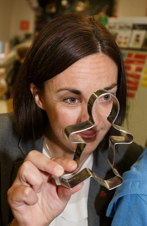 Scottish Labour leader Kezia Dugdale visits Elie Street nursery in Glasgow to highlight the SNP Scottish Government's budget cuts. With a ginger bread man she referred to as 'John Swinney'.  Picture Robert Perry 5th Feb 2016<br /> <br /> Must credit photo to Robert Perry<br /> FEE PAYABLE FOR REPRO USE<br /> FEE PAYABLE FOR ALL INTERNET USE<br /> www.robertperry.co.uk<br /> NB -This image is not to be distributed without the prior consent of the copyright holder.<br /> in using this image you agree to abide by terms and conditions as stated in this caption.<br /> All monies payable to Robert Perry<br /> <br /> (PLEASE DO NOT REMOVE THIS CAPTION)<br /> This image is intended for Editorial use (e.g. news). Any commercial or promotional use requires additional clearance. <br /> Copyright 2014 All rights protected.<br /> first use only<br /> contact details<br /> Robert Perry     <br /> 07702 631 477<br /> robertperryphotos@gmail.com<br /> no internet usage without prior consent.         <br /> Robert Perry reserves the right to pursue unauthorised use of this image . If you violate my intellectual property you may be liable for  damages, loss of income, and profits you derive from the use of this image.