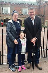 Australian tourist Emma Sandvick, her daughter Lucia, five, and tour guide Alan Doyle outside St James's Palace as news broke of the Duke of Edinburgh's retirement.