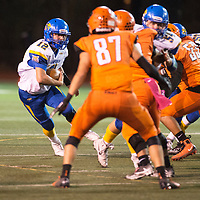 Junior quarterback Vincent Marquez carries the ball for the Bloomfield Bobcats against the Gallup Bengals, Friday Oct. 19, 2018 in Gallup.