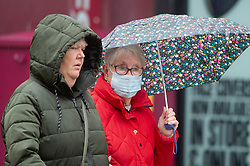 ©Licensed to London News Pictures 13/10/2020  <br /> Bromley, UK. A Shopper wearing a protective face mask.  Autumnal wet weather this afternoon for shoppers in Bromley High Street, Bromley, South East London. Photo credit:Grant Falvey/LNP