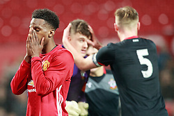 © Licensed to London News Pictures . 12/12/2016 . Manchester , UK . MUFC's JOSHUA BOHUI puts his face in his hands as Southampton celebrate scoring their second goal . Manchester United vs Southampton FA Youth Cup Third Round match at Old Trafford . Photo credit : Joel Goodman/LNP
