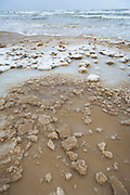 """Ice and snow formations on beach sand with sea in background, nature park """"Ragakāpa"""", Latvia Ⓒ Davis Ulands   davisulands.com"""