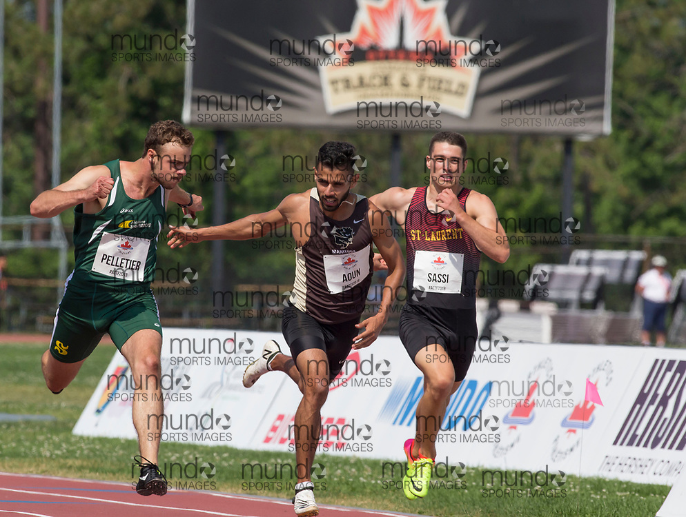 OTTAWA, ON -- 05 July 2018: From left to right, Charles Pelletier, Syed Muhammad Aoun and Philip Sassi lean for the line in 200m qualifying at the start of the 2018 Athletics Canada National Track and Field Championships held at the Terry Fox Athletics Facility in Ottawa, Canada. (Photo by Sean Burges / Mundo Sport Images).