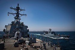 BLACK SEA (Aug. 18, 2018) The Arleigh Burke-class guided-missile destroyer USS Carney (DDG 64) is underway alongside the Romanian navy corvette  ROS Admiral Horia Marcellariu (F 265) in the Black Sea, Aug. 18, 2018. Carney, forward-deployed to Rota, Spain, is on its fifth patrol in the U.S. 6th Fleet area of operations in support of regional allies and partners as well as U.S. national security interests in Europe and Africa. (U.S. Navy photo by Mass Communication Specialist 1st Class Ryan U. Kledzik/Released) 180818-N-UY653-128