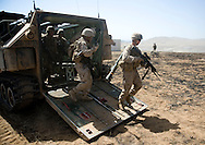 Marines pour out of a Assault Amphibious Vehicle during live-fire exercises for the 2nd Battalion, 5th Marine Regiment at Camp Pendleton.