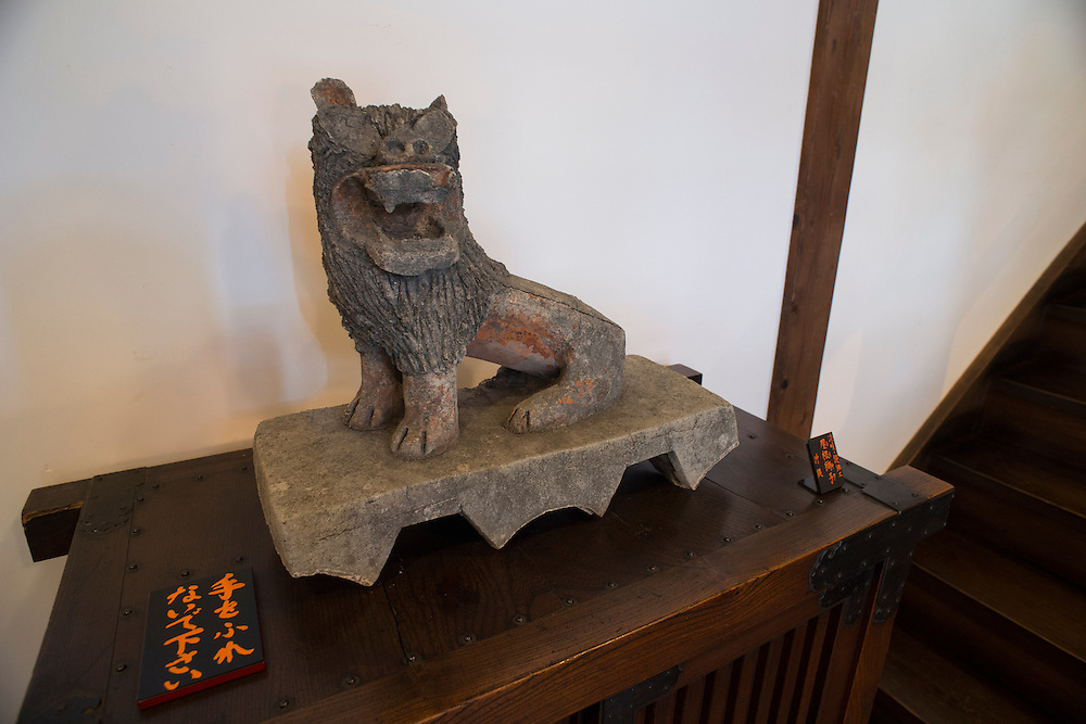 A shishi (Chinese guardian lion) exhibit in the Japan Folk Crafts Museum (Mingeikan), Tokyo, Japan, September 9, 2012. The museum was founded in 1936 by Soetsu Yanagi (1889-1961). It is dedicated to promoting the Mingei folk crafts movement and showing items from all over Japan. A contemporary and friend of Bernard Leach, Yanagi believed in the high aesthetic value of everyday items made by anonymous craftsmen working in set traditions.