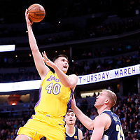 09 March 2018: Los Angeles Lakers center Ivica Zubac (40) goes for the sky hook over Denver Nuggets center Mason Plumlee (24)  during the Denver Nuggets125-116 victory over the Los Angeles Lakers, at the Pepsi Center, Denver, Colorado, USA.