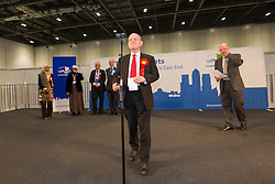 © Licensed to London News Pictures. 12/06/2015. London, UK. Labour's JOHN BIGGS about to make his winning speech at at the Excel Centre in London. Lutfur Rahman was removed from office for fraud and corrupt practices by an election court earlier this year and the 2014 election was rerun as a result. Photo credit : Vickie Flores/LNP
