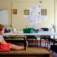 071614  Adron Gardner/Independent<br /> <br /> Five-year-old Ellis Ouellett, rests against his mother Lily at the Expressive Arts Studio in Gallup Wednesday.