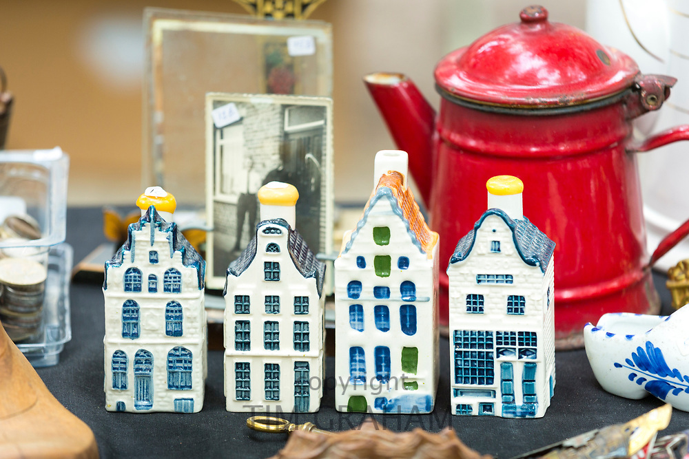 Traditional ceramic Dutch houses, antiques and bric a brac objects at street stall at market in Bruges, Belgium