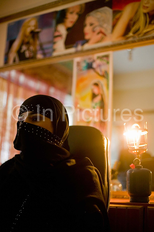 Customer in  beauty parlour, Since the fall of the Taliban there have been an explosion of parlours opening. Under the Taliban they were banned with whipping and amputations common punishments.